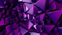 Royalty Free Video of Rotating Purple 3D Triangles