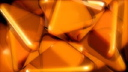 Royalty Free Video of a Rotating Orange 3D Triangles