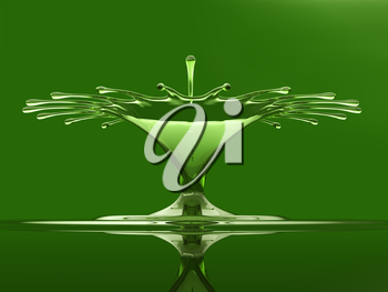 Splash of colorful green liquid with droplets and water crown. Over green