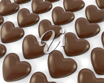 Many heart shaped chocolate candies, isolated on white background