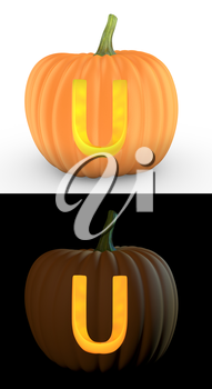 U letter carved on pumpkin jack lantern isolated on and white background