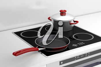 Frying pan and cooking pot at the induction stove