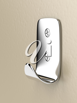 Silver wall hook on brown wall