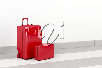 Red suitcase and briefcase at the airport