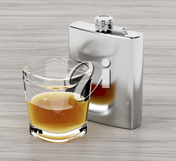 Hip flask and a glass of brandy on wooden table