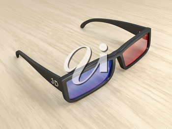 Anaglyph 3D glasses on wood table