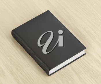 Book with black cover on wooden table