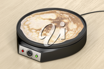 Electric pancake maker on wooden table