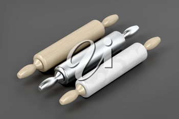 Three rolling pins from different materials on grey background
