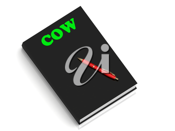 COW- inscription of green letters on black book on white background