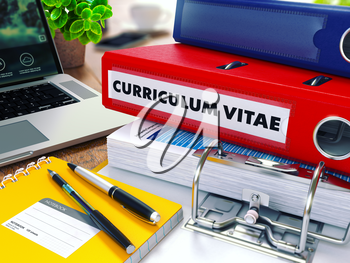 Curriculum Vitae - Red Ring Binder on Office Desktop with Office Supplies and Modern Laptop. Business Concept on Blurred Background. Toned Illustration. 3d Render.