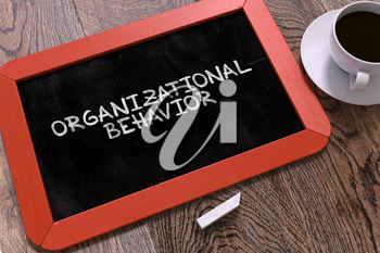 Organizational Behavior Concept Hand Drawn on Red Chalkboard on Wooden Table. Business Background. Top View. 3d Render.