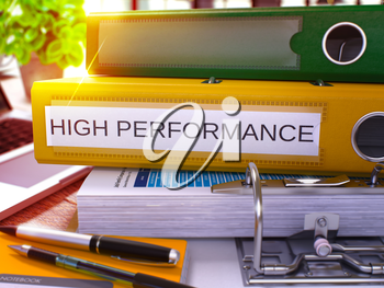 High Performance. Yellow Ring Binder with Inscription High Performance on Background of Working Table with Office Supplies and Laptop. High Performance Concept on Blurred Background. 3D Render.