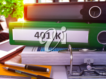 401K - Green Office Folder on Background of Working Table with Stationery and Laptop. 401K Business Concept on Blurred Background. 401K Toned Image. 3D.