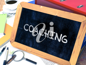 Hand Drawn Coaching Concept  on Chalkboard. Blurred Background. Toned Image. 3D Render.