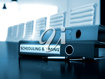 Binder with Inscription Scheduling & Timing on Desk. Scheduling & Timing. Business Illustration on Blurred Background. 3D.