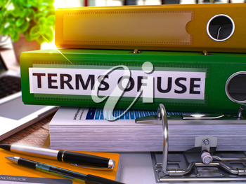 Terms of Use - Green Office Folder on Background of Working Table with Stationery and Laptop. Terms of Use Business Concept on Blurred Background. Terms of Use Toned Image. 3D.