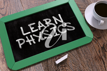 Handwritten Learn Physics on a Green Chalkboard. Top View Composition with Chalkboard and White Cup of Coffee. 3D Render.