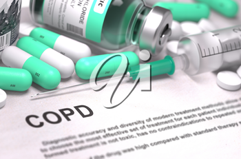COPD - Chronic Obstructive Pulmonary Disease - Printed Diagnosis with Blurred Text. On Background of Medicaments Composition - Mint Green Pills, Injections and Syringe.