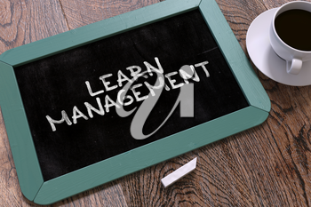 Handwritten Learn Management on a Blue Chalkboard. Top View Composition with Chalkboard and White Cup of Coffee. 3D Render.