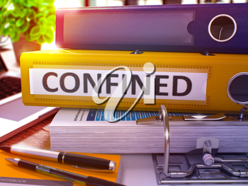 Confined - Yellow Office Folder on Background of Working Table with Stationery and Laptop. Confined Business Concept on Blurred Background. Confined Toned Image. 3D Render.