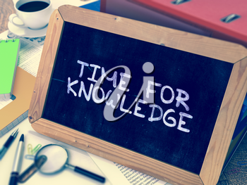 Time for Knowledge Concept Hand Drawn on Chalkboard on Working Table Background. Blurred Background. Toned Image. 3D Render.