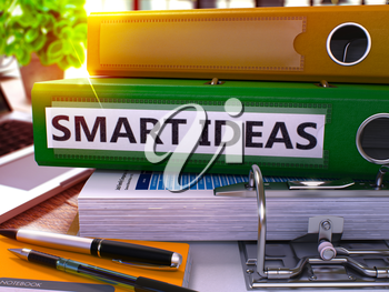 Green Ring Binder with Inscription Smart Ideas on Background of Working Table with Office Supplies and Laptop. Smart Ideas Business Concept on Blurred Background. 3D Render.