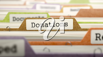 Donations Concept on Folder Register in Multicolor Card Index. Closeup View. Selective Focus. 3D Render.