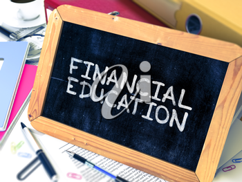 Financial Education Concept Hand Drawn on Chalkboard on Working Table Background. Blurred Background. Toned Image. 3D Render.