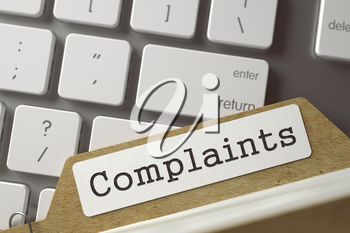 Complaints written on  Archive Bookmarks of Card Index on Background of White Modern Computer Keypad. Archive Concept. Closeup View. Selective Focus. Toned Illustration. 3D Rendering.