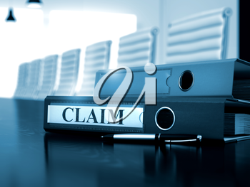 Claim - Business Concept. Office Binder with Inscription Claim on Wooden Working Desktop. Claim - Office Binder on Office Desk. 3D.