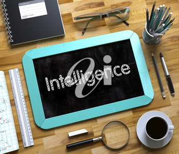 Intelligence. Business Concept Handwritten on Mint Small Chalkboard. Top View Composition with Chalkboard and Office Supplies on Office Desk. Small Chalkboard with Intelligence Concept. 3d Rendering.