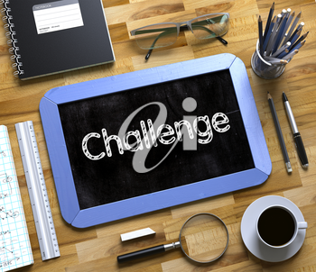 Small Chalkboard with Challenge Concept. Top View of Office Desk with Stationery and Blue Small Chalkboard with Business Concept - Challenge. 3d Rendering.