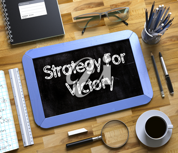 Strategy For Victory - Blue Small Chalkboard with Hand Drawn Text and Stationery on Office Desk. Top View. Strategy For Victory Concept on Small Chalkboard. 3d Rendering.