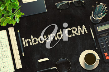 Inbound CRM - Black Chalkboard with Hand Drawn Text and Stationery. Top View. 3d Rendering. Toned Image.
