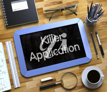 Killer Application Concept on Small Chalkboard. Top View of Office Desk with Stationery and Blue Small Chalkboard with Business Concept - Killer Application. 3d Rendering.