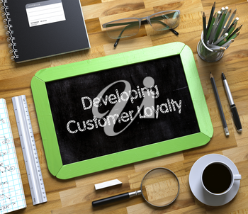 Small Chalkboard with Developing Customer Loyalty Concept. Small Chalkboard with Developing Customer Loyalty. 3d Rendering.