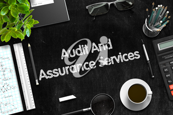 Audit And Assurance Services Handwritten on Black Chalkboard. Top View of Black Office Desk with a Lot of Business and Office Supplies on It. 3d Rendering.