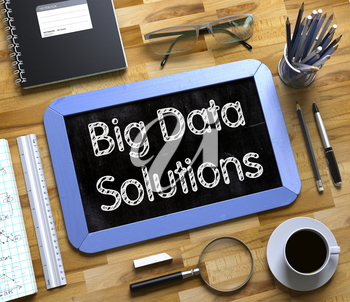 Big Data Solutions Concept on Small Chalkboard. Blue Small Chalkboard with Handwritten Business Concept - Big Data Solutions - on Office Desk and Other Office Supplies Around. Top View. 3d Rendering.