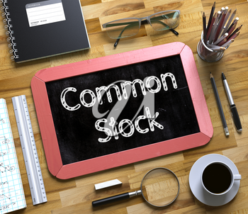 Small Chalkboard with Common Stock Concept. Top View of Office Desk with Stationery and Red Small Chalkboard with Business Concept - Common Stock. 3d Rendering.