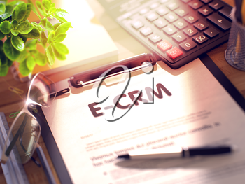 E-CRM on Clipboard. Composition with Clipboard on Working Table and Office Supplies Around. 3d Rendering. Blurred and Toned Image.