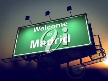 Welcome to Madrid - Green Billboard on the Rising Sun Background.