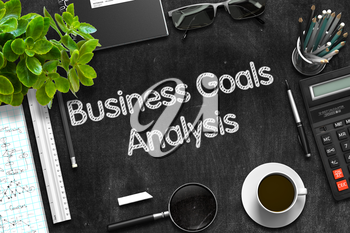 Business Goals Analysis - Black Chalkboard with Hand Drawn Text and Stationery. Top View. 3d Rendering.