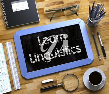 Learn Linguistics Concept on Small Chalkboard. Learn Linguistics Handwritten on Blue Small Chalkboard. Top View of Wooden Office Desk with a Lot of Business and Office Supplies on It. 3d Rendering.