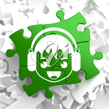 Happy Boy with Headphones Icon on Green Puzzle. Sound, Music Concept.