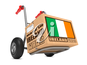 Cardboard Box with Flag of Ireland and Made in Ireland Slogan on Hand Truck White Background. Free Shipping Concept.