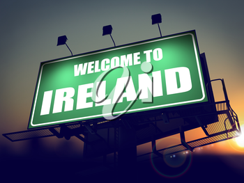 Welcome to Ireland - Green Billboard on the Rising Sun Background.