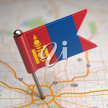 Small Flag of Mongolia on a Map Background with Selective Focus.