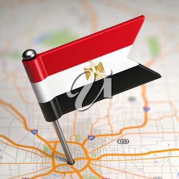 Small Flag of Egypt Sticked in the Map Background with Selective Focus.