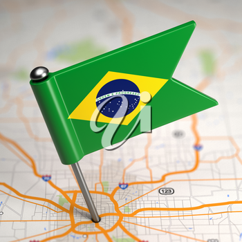 Small Flag of Brazil Sticked in the Map Background with Selective Focus.